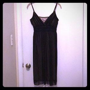 Black midi dress with mesh overlay over nude slip